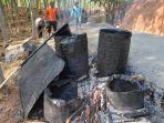 penggunaan-kayu-bakar-untuk-memanaskan-aspal-agar-bisa-digunakan_20181027_151548.jpg