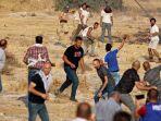 pengunjuk-rasa-palestina-dan-pemukim-israel-bentrok.jpg