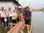 penyaluran-bantuan-donasi-kepada-warga-desa-timbulsoko-kecamatan-sayung-kabupaten-demak.jpg