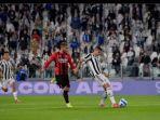 penyerang-juventus-alvaro-morata-mencetak-gol-ke-gawang-ac-milan-di-liga-italia-2021-2022.jpg