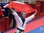 peraih-medali-emas-taekwondo-defia-rosmaniar_20180819_214117.jpg