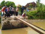 perbaikan-jembatan-penghuburing-dengan-desa-si52021.jpg
