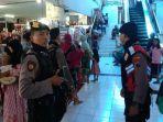 personel-polisi-berjaga-di-pasar-pagi-kota-tegal_20180611_114104.jpg