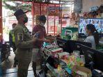 petugas-gabungan-melakukan-patroli-terhadap-minimarket-dan-toko-di-temanggung.jpg