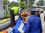 petugas-mengevakuasi-korban-tew2021-pagi.jpg
