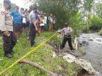 polisi-mengamankan-tempat-kejadian-perkara-orang-meninggal-di-sungai-desa-dawuhan.jpg