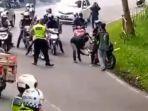 polisi-merazia-knalpot-racing-pada-pengguna-motor-di-bandung.jpg