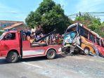 proses-evakuasi-bus-yang-ditabrak-oleh-truk-tronton-di-jalan-pantura-cepiring_20180329_155121.jpg