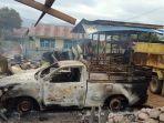 puing-mobil-dan-bangunan-yang-terbakar-di-kampung-ikebo-distrik-kamuu-dogiyai-papua.jpg