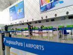 ruang-check-in-bandara-ahmad-yani-semarang-masih-lengang-meski-penebangan-berangsur-normal.jpg