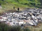 rumah-guru-yang-dibakar-kkb-di-kampung-dambet-distrik-beoga-kabupaten-puncak-papua.jpg