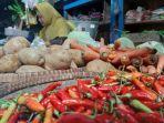 salah-satu-pedagang-sayuran-dan-cabai-di-pasar-suradadi-kabupaten-tegal.jpg