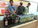 satreskrim-polres-demak-mengamankan-puluhan-botol-miras-dan-penjual-dan-pem.jpg