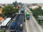 sejumlah-kendaraan-melintasi-jalur-pantura-brebes-tepatnya-di-kaligangsa-kecamatan.jpg