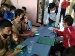 siswa-tengah-mengikuti-technical-meeting-di-gedung-dekopinda-kudus-4-10-2021.jpg
