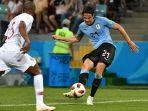 striker-uruguay-edinson-cavani-cetak-gol-kedua-ke-gawang-portugal_20180701_082337.jpg