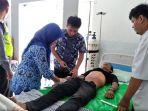 tenaga-medis-tengah-memberikan-pertolongan-kepada-kharis-korban-tertabrak-truk_20180417_161806.jpg