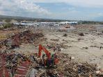 tim-sar-gabungan-melakukan-pencarian-korban-gempa-tsunami_20181004_204257.jpg