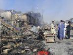 warga-afghanistan-memeriksa-toko-toko-yang-hancur-akibat-bentrokan.jpg