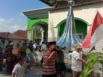 warga-mengarak-mustaka-masjid-roudlotul-abidin-desa-tlogorejo-tegowanu-sabtu-562021.jpg
