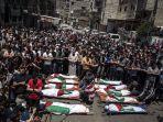 warga-palestina-menggelar-shalat-jenazah-untuk-dua-wanita-dan-delapan-anak.jpg