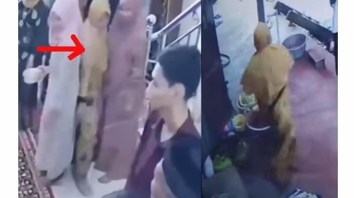 Terduga pelaku pencurian yang merupakan emak-emak memakai baju dan jilbab berwarna kuning.