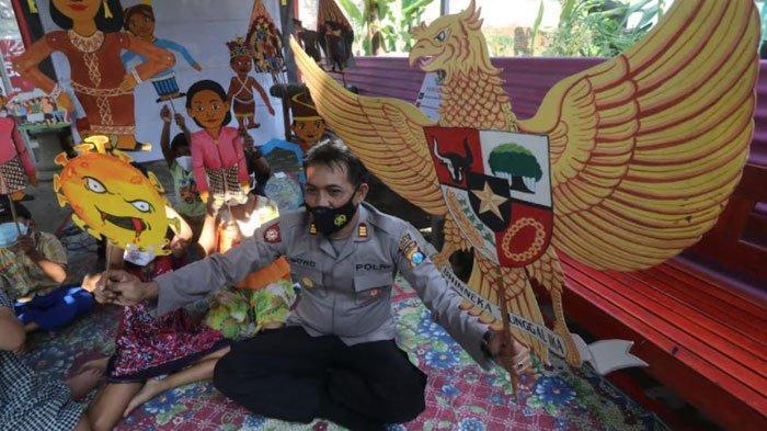 Peringati Hari Lahir Pancasila, Polsek Puncu Ajak Anak-anak di Kediri Mewarnai Burung Garuda