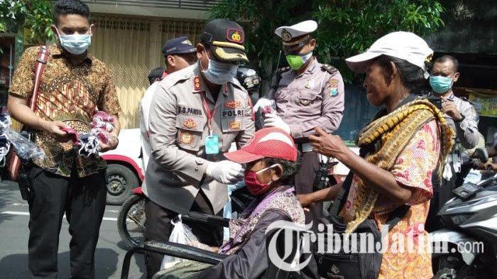 Cegah Penyebaran Covid-19, Polres Tulungagung Bagikan 20.000 Masker Kain Buatan UMKM Lokal