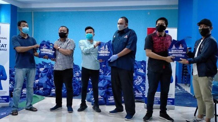 Demokrat Jatim Gandeng HMI, PMII dan GMNI Salurkan Ribuan Paket Sembako pada Warga Terdampak Corona