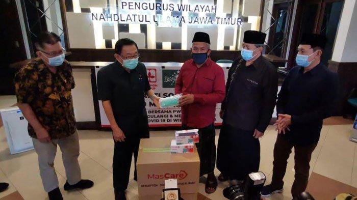 PWNU Jatim Salurkan Masker dan Libatkan Ulama Bangkalan untuk Mengajak Warga Madura Taat Prokes