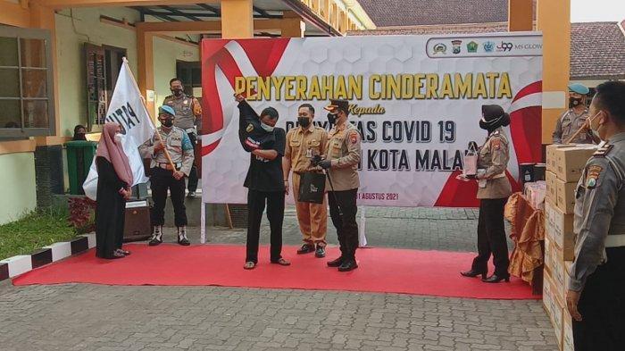 Kapolresta Malang Kota Kunjungi Isoter BPSDM, Berikan Cinderamata Bagi Penyintas Covid