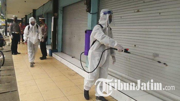 Tekan Penularan Covid-19, Satlantas Polres Madiun Semprotkan Disinfektan di Pasar dan Pangkalan Ojek