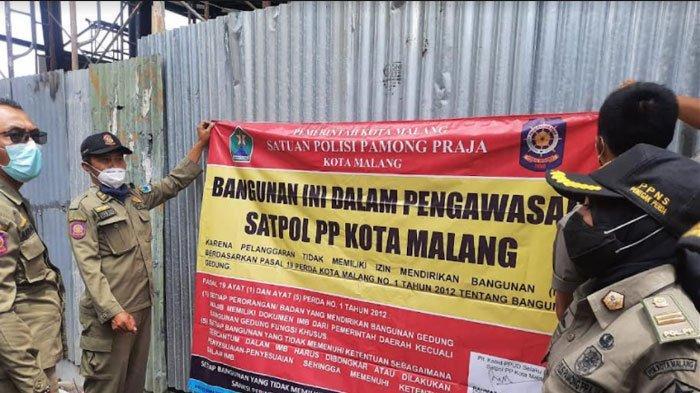 Tidak Punya IMB, Bangunan di Jalan Simpang Borobudur Disegel Satpol PP Kota Malang