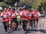 33-pelari-berlari-sejauh-33-km-untuk-peringati-hut-ke-33-arema-fc.jpg