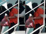 anggota-densus-88-membawa-terduga-teroris-dari-makassar-setibanya-di-bandara-soekarno-hatta.jpg