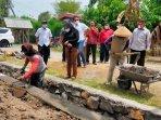 anggota-komisi-v-dpr-ri-sadarestuwati-meninjau-pembangunan-saluran-irigasi-di-nganjuk.jpg