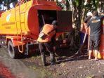 badan-penanggulangan-bencana-daerah-bpbd-banyuwangi-memberikan-bantuan-air-bersih.jpg