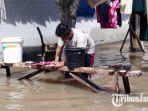 banjir-melanda-desa-glundengan-kecamatan-wuluhan-jember-selasa-1932019.jpg