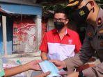 berita-gresik-bantuan-warga-gresikdapat-bantuan-beras-dan-masker-dari-yayasan-budha-tzu-chi.jpg
