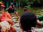 berita-pasuruan-ketua-dprd-kabupaten-pasuruan-rela-berendam-di-banjir.jpg