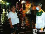 berita-pasuruan-relawan-gus-ipul-mas-adi-turun-langsung-membantu-warga-korban-banjir.jpg