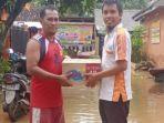 berita-surabaya-relawan-bmi-saat-berada-di-lokasi-bencana-banjir-di-lumajang.jpg