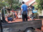 bpbd-kabupaten-bangkalan-menggelontorkan-ratusan-keping-genteng-dan-asbes.jpg