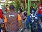 bpbd-kabupaten-kediri-saat-melakukan-penjemputan-para-pekerja-migran-indonesia.jpg