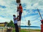 bpbd-kabupaten-tulungagung-melepas-early-warning-system-ews-di-pantai-bayem-tulungagung.jpg