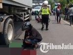 driver-ojek-online-tewas-terlindas-truk-trailer-di-bundaran-waru-surabaya.jpg