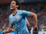edinson-cavani-merayakan-gol-uruguay-ke-gawang-portugal_20180701_080219.jpg