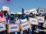 hijabers-dari-mojokerto-ikut-ramaikan-may-day-di-surabaya_20180501_153206.jpg