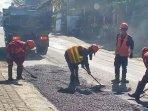 ilustrasi-perbaikan-jalan-di-desa-pandanrejo-kota-batu-2021.jpg