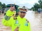 kasatlantas-polres-madiun-akp-imam-mustolih-saat-ditemui-kala-banjir-di-kabupaten-madiun.jpg